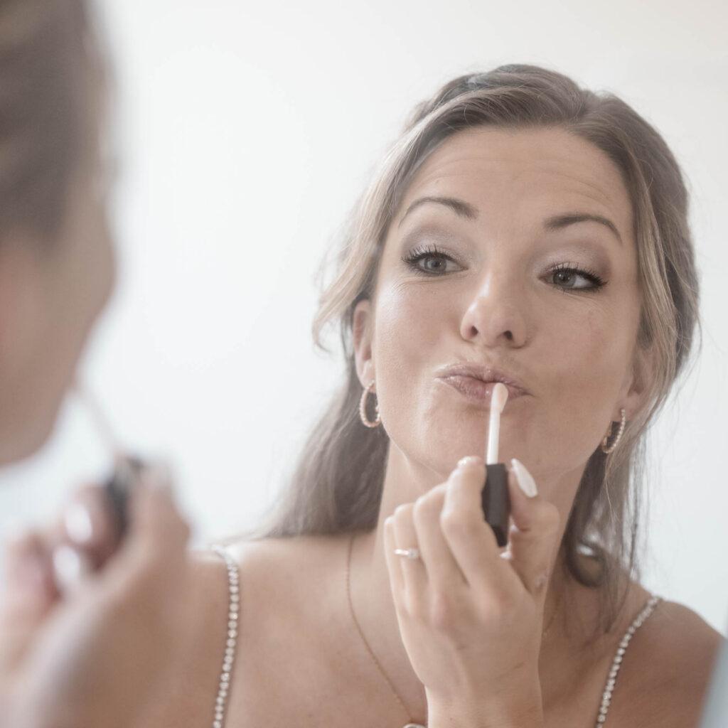 Bruid make-up trouwdag fotografie